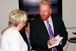Tony Inman signs a book at his book launch event